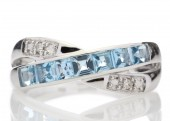 9ct White Gold Diamond and Blue Topaz Half Eternity Ring